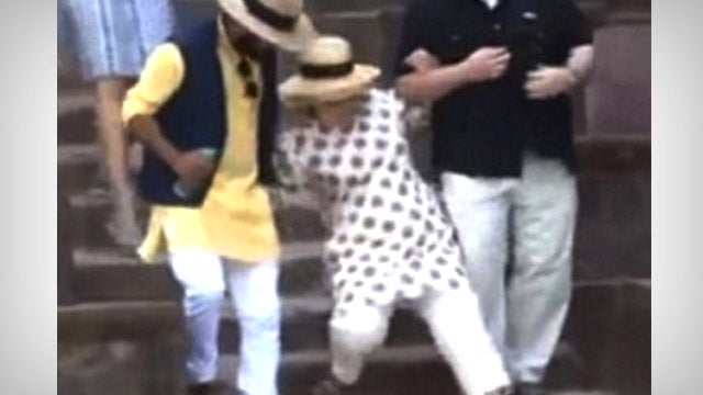 The World Rejection Tour: Hillary Rips America, Falls Down Stairs in India