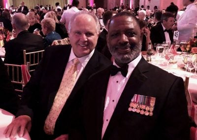 JOEL, A RETIRED MARINE AND LONGTIME LISTENER, AND I AT THE 2018 MC-LEF GALA