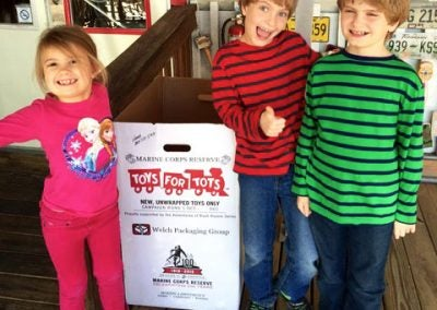 RUSH REVERE IS PROUD TO SPONSOR TOYS FOR TOTS ANNUALLY
